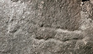 Warrah Trig Road - an engraving of an axe
